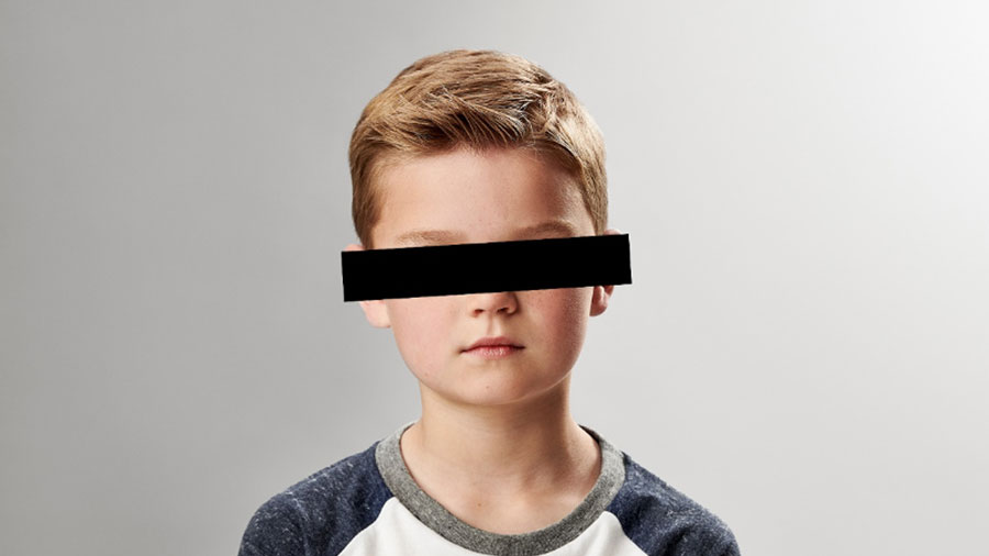 boy with black bar over eyes