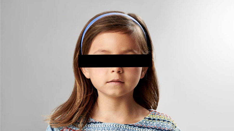 young girl with black bar over eyes