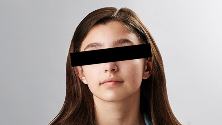 teenage girl with black bar over eyes